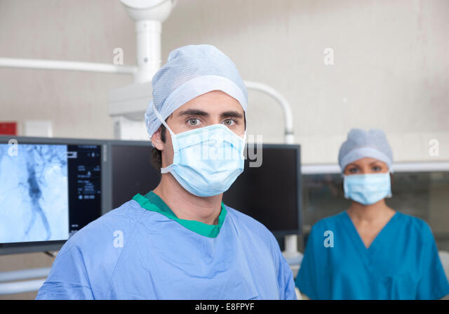 Two doctors standing in operating theatre - Stock Image