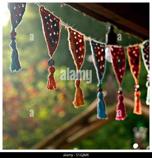 Crochet bunting in evening light - Stock-Bilder