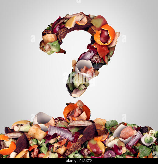 Composting questions as a compost pile of rotting kitchen fruits egg shells and vegetable food scraps shaped as - Stock Image