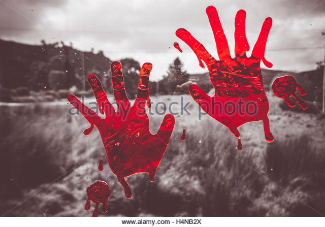 Scary horizontal scene of bloody handprints pressed against outback home glass. Window pain - Stock Image