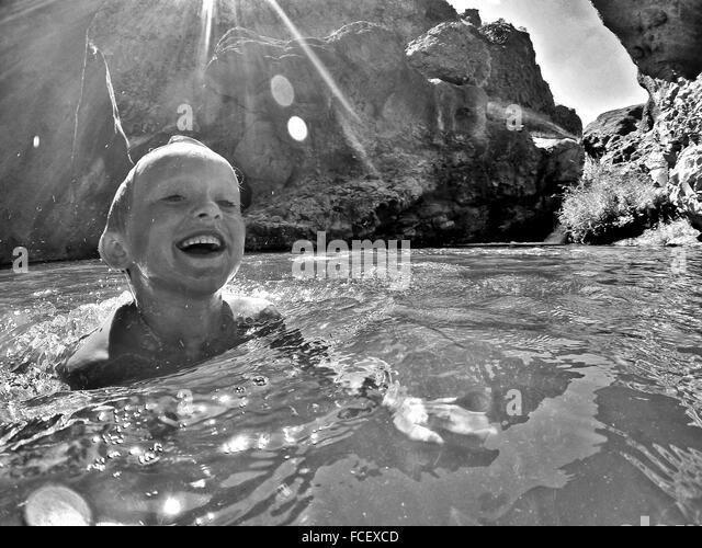 Boy Swimming In Lake - Stock Image