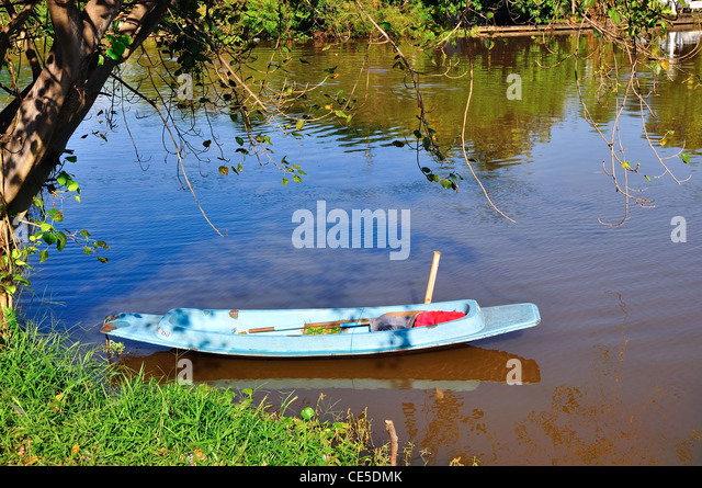 Row boat with reflection in a pond - Stock Image