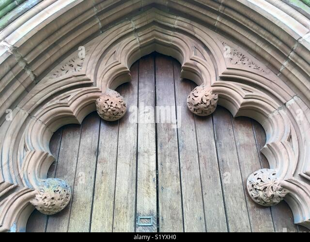 Gothic tracery framing the entrance door to the Erdington Abbey Church, 1848-50. (The church of Saints Thomas and Edmund of Canterbury). Designed by Charles Hansom. - Stock Image