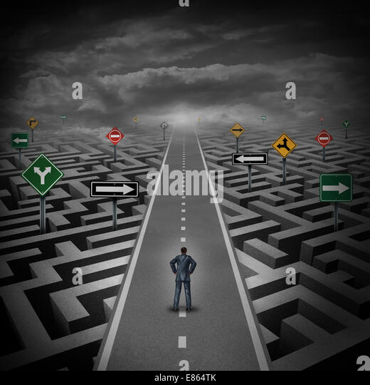 Crisis solution concept as a businessman standing on a straight road through a maze or labyrinth with confusing - Stock Image