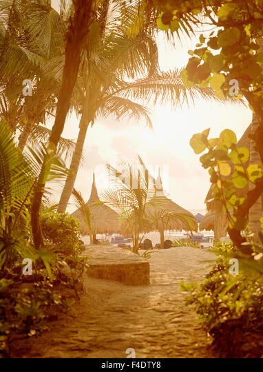 Sunrise view of the beach palapas at  Maroma Spa and Resort. Riviera Maya,Yucatan,Mexico. - Stock Image