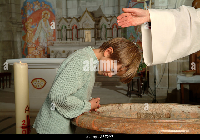Christian baptism Sacrament, anointing a child?s head with holy water. - Stock-Bilder
