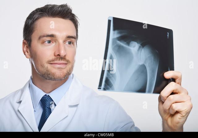 Doctor examining x-ray - Stock Image
