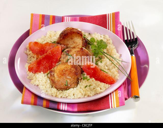 Pork with grapefruit - Stock Image