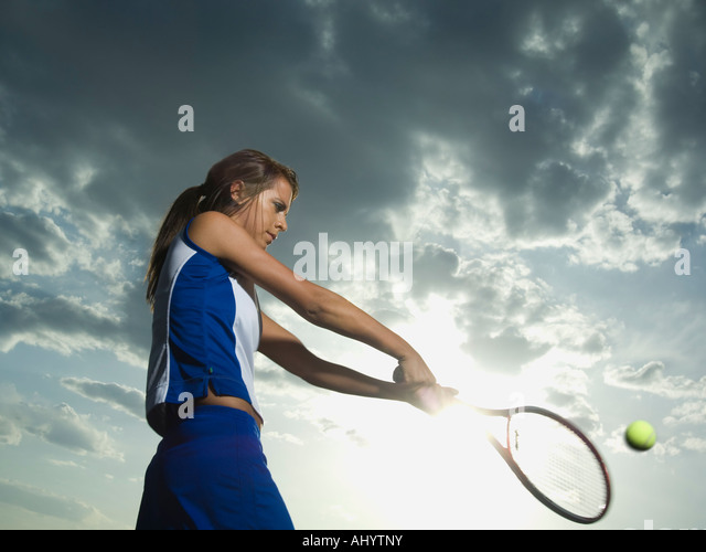 Low angle view of tennis player - Stock Image