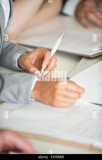 Business people negotiating contract, cropped - Stock-Bilder