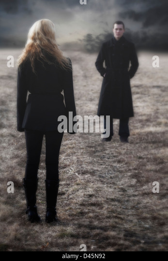 a conflict between man and woman - Stock Image