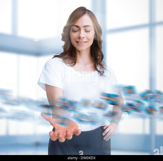 Stylish businesswoman choosing picture - Stock Image
