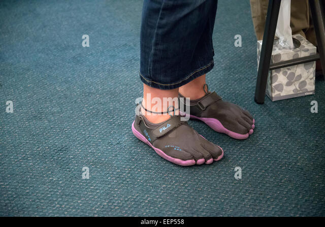 Minimalist footwear or barefoot shoes on a teenager. - Stock Image