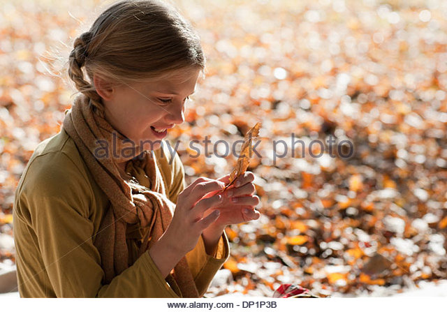 Girl outdoors in autumn - Stock Image