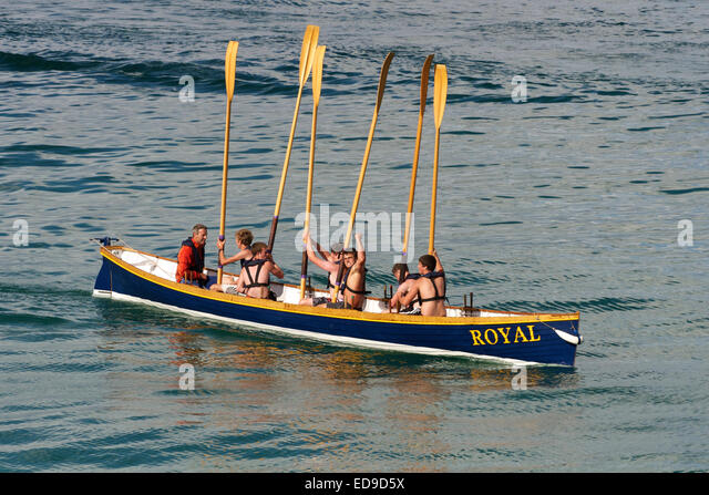 Triumphant oarsmen of a Cornish pilot gig after winning their race, Newquay - Stock Image