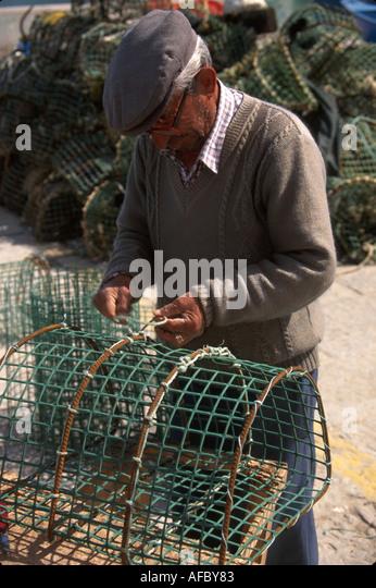 Portugal Cascais Atlantic Coast Praia do Peixe Fisherman's Beach mestre do mar fisherman traps - Stock Image