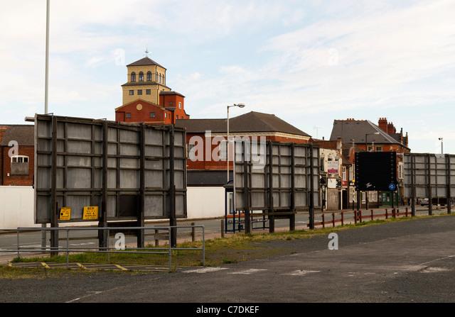 Roadside advertising hoardings or billboards UK - Stock Image