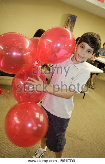 Miami Florida Miami Art Central Festival Mexico Hispanic boy play balloons heritage celebration - Stock Image