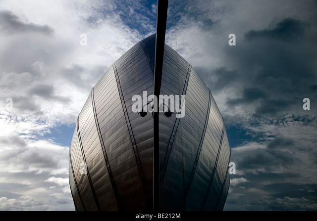 The futuristic Glasgow Science Museum, Glasgow, Scotland, UK reflected in a glass window. - Stock Image