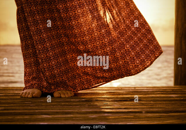 Close up of woman's dress blowing in the wind - Stock Image