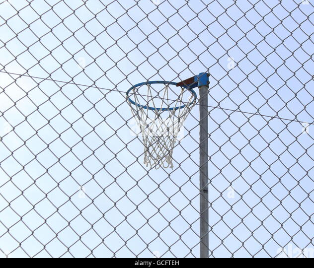Netball ring inside playground - Stock Image