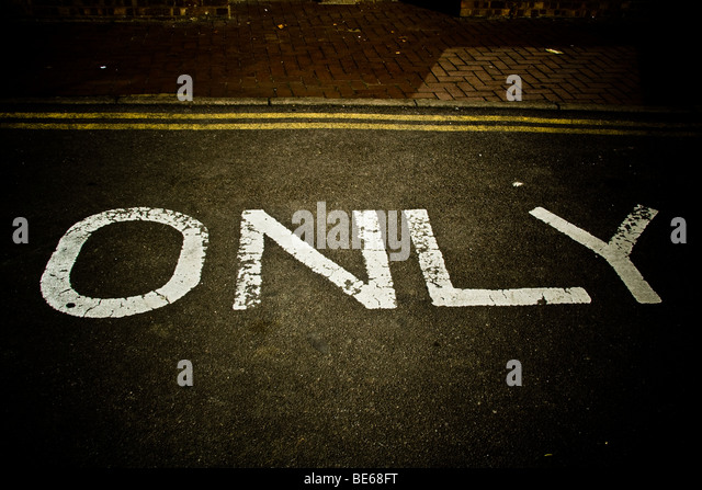 only written in paint on the road. - Stock Image