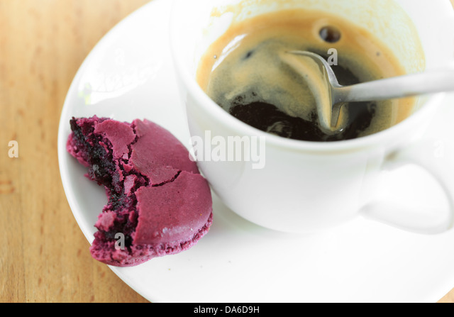 Cup of espresso coffee with macaron - Stock Image