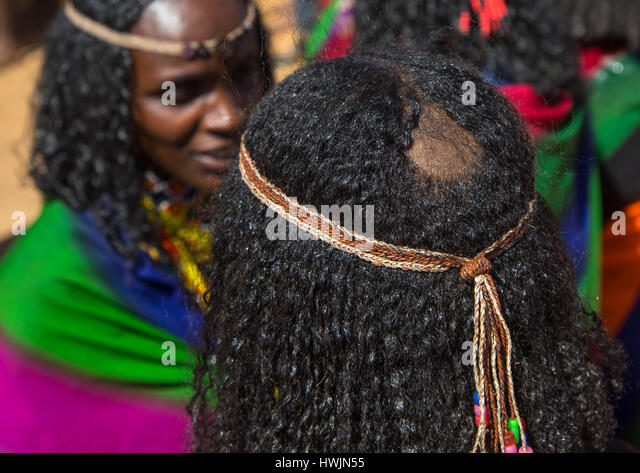 Tonsure that indicates the Borana tribe girl is virgin during the Gada system ceremony, Oromia, Yabelo, Ethiopia - Stock-Bilder