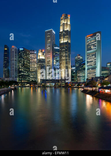 Boat Quay and the Singapore skyline and river at dusk. - Stock Image