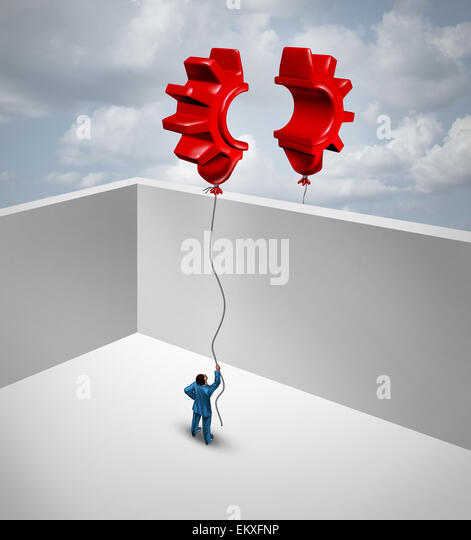 Overcome business barriers as two partners separated by walls in a joint effort to merge two flying red balloons - Stock Image
