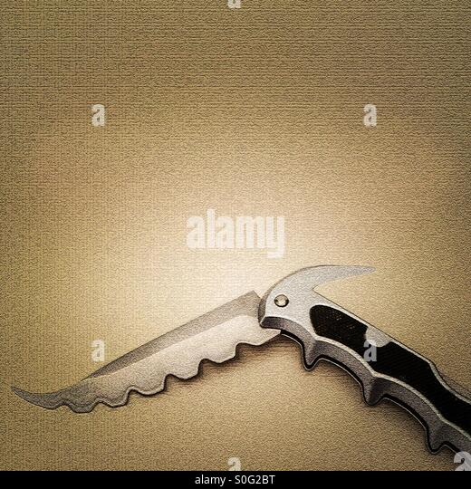 Artistic impression of futuristic steampunk tribal pocket knife - Stock Image