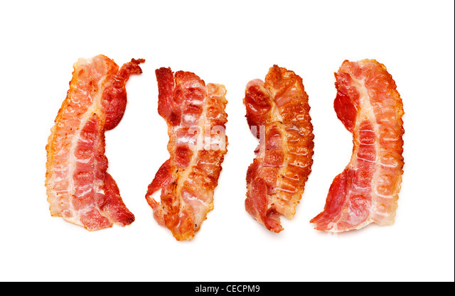 Bacon rashers on white background - Stock Image