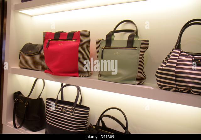 Hong Kong China International Airport HKG terminal concourse gate area shopping upscale luxury Kate Spade women's - Stock Image