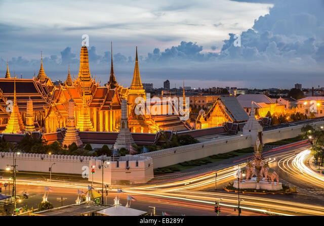 Grand palace at twilight with light from traffic in Bangkok, Thailand - Stock Image