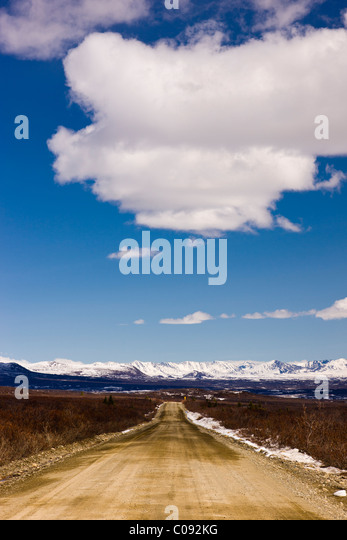 View of the Denali Highway and Alaska Range foothills just before the Susitna River Bridge, Southcentral Alaska, - Stock Image