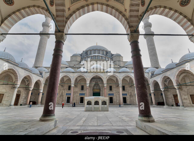 Istanbul, Turkey - April 17, 2017: Courtyard of Suleymaniye Mosque at early morning with few tourists visiting the - Stock Image