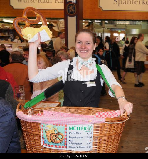 Brezel seller in Munich Oktoberfest beer tent - Stock Image