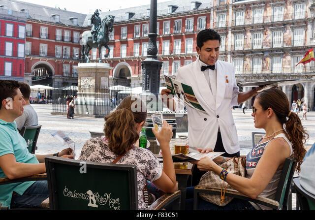 Spain Europe Spanish Hispanic Madrid Centro Plaza Mayor Main Square bronze statue King Philip III Cerveceria Plaza - Stock Image