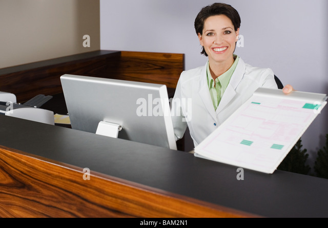 Dentist with form - Stock Image
