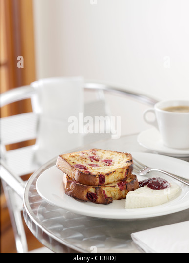 Plate of fruit bread with cream - Stock Image