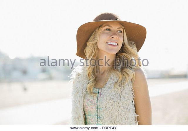 Woman wearing sunhat on beach - Stock Image