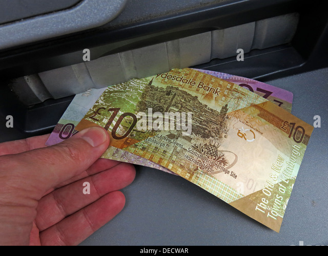 Taking Scottish sterling notes from a RBS cash machine, in Edinburgh, Midlothian, Scotland - Stock Image