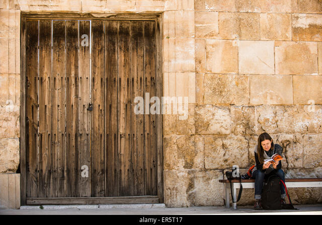 Woman reading a guidebook, Roman Theatre, Amman, Jordan, Middle East - Stock Image