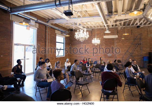 Business people in conference audience - Stock Image