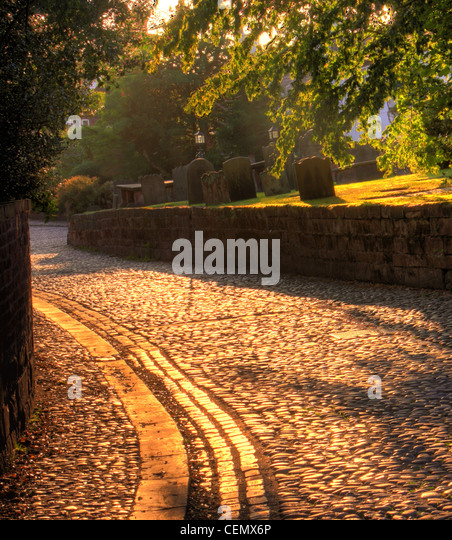 The cobbled area in Grappenhall Village, South Warrington at Sunset. (Church lane, adjacent to St Wilfrids parish - Stock Image