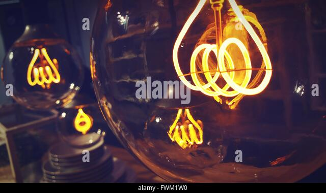 Close-Up Of Illuminated Light Bulbs - Stock Image