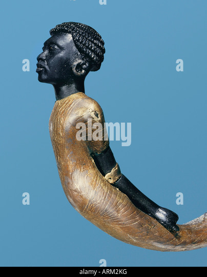 An African adversary carved on the lower end of a ceremonial cane, from the tomb of the pharaoh Tutankhamun - Stock Image