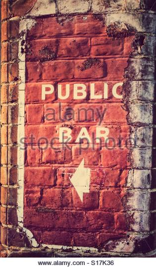 Public Bar sign on a brick wall - Stock Image