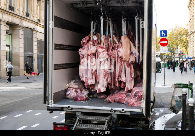 Truck delivering butchered meat on Paris street - Stock Image