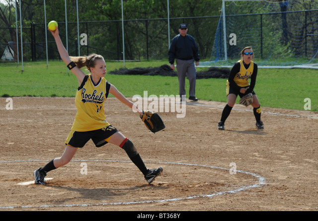 pitcher in a high school softball - Stock Image